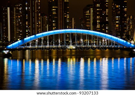 "night time colorful reflection of ""Eitai"" Bridge illumination in waters of Sumida river of Tokyo , Japan"