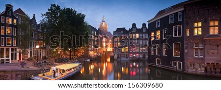 Night time illuminations of the stunning neo-Renaissance St Nicholas Church (1842) in the heart of Amsterdam. Stitched panoramic image.