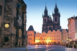Night time illuminations of the the Old Town Hall (15th Century), Town Square and fairy tale Church of our Lady Tyn (1365) in the Magical city of Prague. Astronomical clock visible.