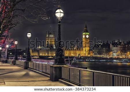 Night time Photo of Street Lamp on South Bank of River Thames with Big Ben and Palace of Westminster in Background, London, England, UK