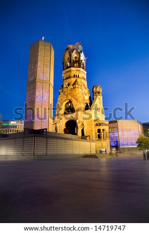 Night time view of illuminated Kaiser-Wilhelm Memorial Church in Berlin