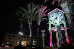 Night time view of the public clock tower in Garden Grove, California, USA.
