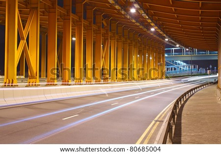 night traffic in the tunnel - stock photo
