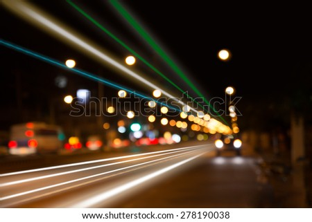 night traffic lights at intersection. The city lights. Motion blur. Abstract background