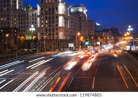 night traffic on city embankment in Moscow