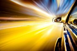 Night traffic,shoot from the window of rush car,motion blur steet light.