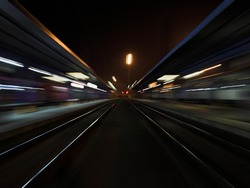 Night train station with parallel lights paths speed