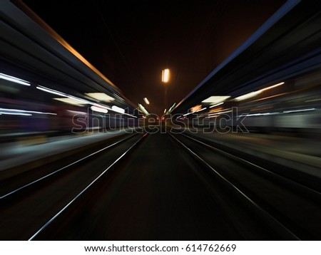 Night train station with parallel lights paths speed  #614762669