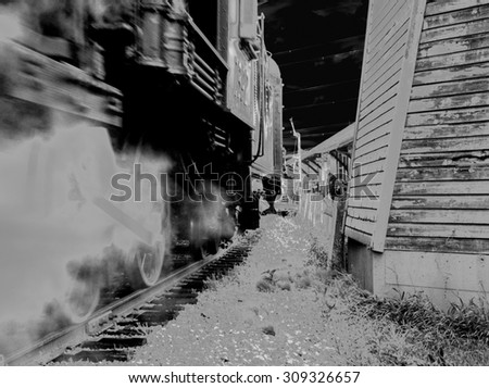 NIGHT TRAIN.  Steam locomotive with a full head of steam underway on the Canadian Prairies in black and white format
