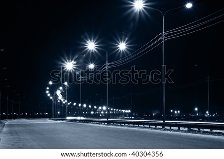 Night urban street with lights from lanterns - stock photo