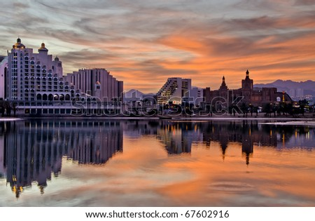 Night view and colorful sunset at the area of resort hotels and recreation spots in Eilat city, Israel - stock photo