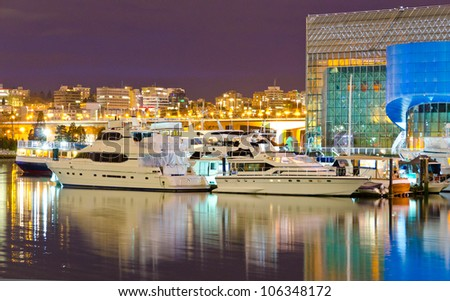 Night view at the marina with luxury yachts in Vancouver