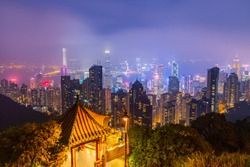 Night view from Victoria Peak  with illuminated buildings at twilight. Victoria harbour view in Hong Kong.
