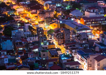 Night view of a crowded urban district packed with narrow multi-storey houses and poorer residential areas in Mandaluyong, Metro Manila, Philippines. Сток-фото ©
