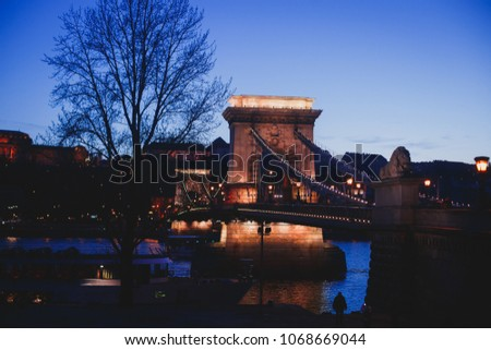 Night view of a famous Budapest Szechenyi Chain Bridge, a suspension bridge that spans the River Danube between Buda and Pest, the western and eastern sides of Budapest #1068669044