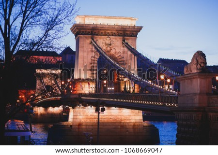 Night view of a famous Budapest Szechenyi Chain Bridge, a suspension bridge that spans the River Danube between Buda and Pest, the western and eastern sides of Budapest #1068669047