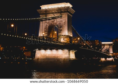 Night view of a famous Budapest Szechenyi Chain Bridge, a suspension bridge that spans the River Danube between Buda and Pest, the western and eastern sides of Budapest #1068669050