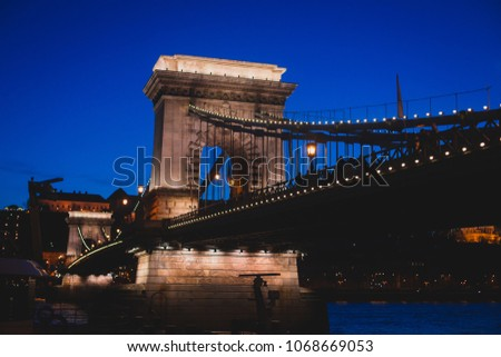 Night view of a famous Budapest Szechenyi Chain Bridge, a suspension bridge that spans the River Danube between Buda and Pest, the western and eastern sides of Budapest #1068669053
