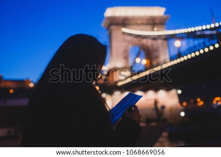 Night view of a famous Budapest Szechenyi Chain Bridge, a suspension bridge that spans the River Danube between Buda and Pest, the western and eastern sides of Budapest #1068669056