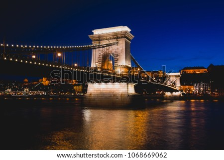 Night view of a famous Budapest Szechenyi Chain Bridge, a suspension bridge that spans the River Danube between Buda and Pest, the western and eastern sides of Budapest #1068669062