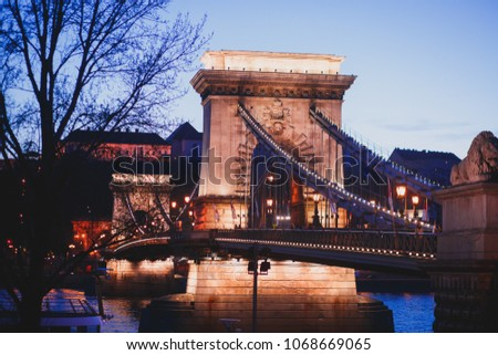 Night view of a famous Budapest Szechenyi Chain Bridge, a suspension bridge that spans the River Danube between Buda and Pest, the western and eastern sides of Budapest #1068669065