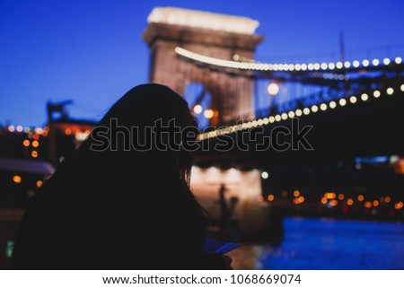 Night view of a famous Budapest Szechenyi Chain Bridge, a suspension bridge that spans the River Danube between Buda and Pest, the western and eastern sides of Budapest #1068669074