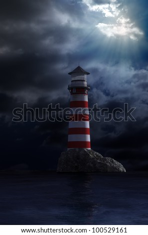 Night view of a red and white old lighthouse