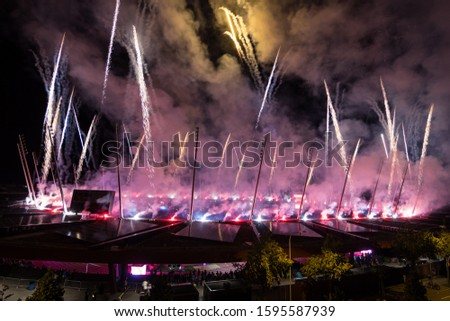 Night view of a stadium with fireworks show.