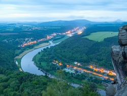 Night view of Bad Schandau, Koenigstein and curve of Elbe river.
