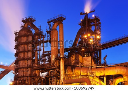 Night view of blast furnace equipment of the metallurgical plant - stock photo