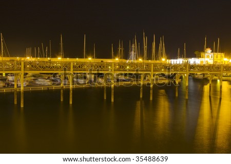 Night view of boats in a marine with reflexes in the sea of Lanzarote island