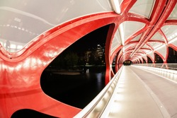 Night view of Calgary's Peace Bridge. The bridge features a red and white helix design. Opened in March 2012, it connects the extensive Bow River Pathway on the north and south sides of the Bow River.
