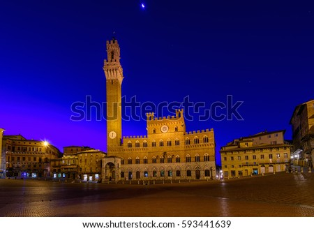 Shutterstock Night view of Campo Square (Piazza del Campo), Palazzo Pubblico and Mangia Tower (Torre del Mangia) in Siena, Tuscany, Italy. Siena is capital of province of Siena.