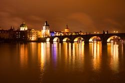 Night view of Charles bridge and Church of St. Francis. Prague, Czech Republic