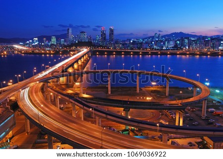 Night view of Han River, Seoul, Korea, with Cheongdam Bridge and Gangnam visible #1069036922