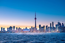 Night view of iconic landmarks and buildings of Toronto city skyline from Centre Island, Canada