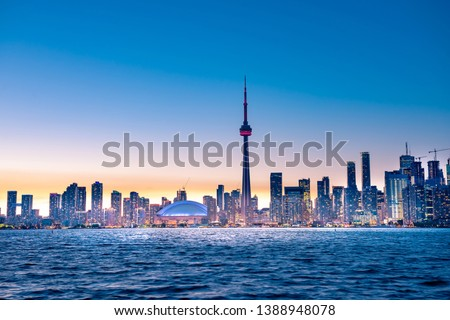 Night view of iconic landmarks and buildings of Toronto city skyline from Centre Island, Canada #1388948078