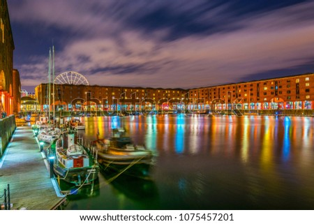 Night view of illuminated albert dock in Liverpool, England