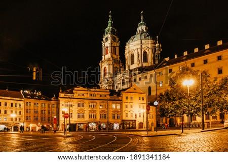 Night view of illuminated Church of Saint Nicholas,Malostranske namesti,Prague,Czech republic.Baroque church in the Lesser Town of Prague.Night city scene.Famous tourist destination.Czech architecture