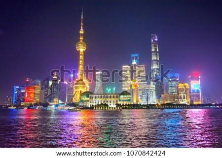 Night view of Illuminated Shanghai skyline and Huangpu river at night, Shanghai, China #1070842424