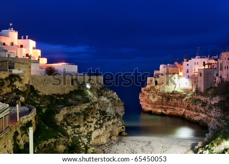 """Night  view of little village """"Polignano a mare"""" and it's bay in  south Italy"""