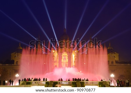 night view of Magic Fountain light show in Barcelona, Spain - stock photo