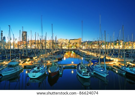 Night view of Marina Port Vell in Barcelona - Spain (long exposure)