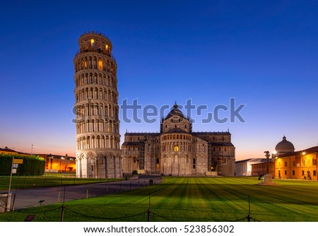 Night view of Pisa Cathedral (Duomo di Pisa) with Leaning Tower of Pisa (Torre di Pisa) on Piazza dei Miracoli in Pisa, Tuscany, Italy. The Leaning Tower of Pisa is one of the main landmark of Italy