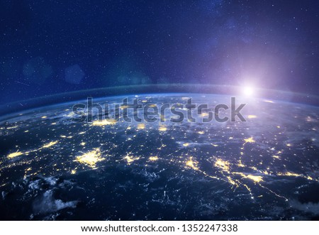 night view of planet Earth from space, beautiful high tech  background with sun and stars, closeup, original image furnished by NASA #1352247338