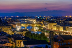 Night view of Ponte Vecchio over Arno River in Florence, Italy. Architecture and landmark of Florence. Skyline of Florence