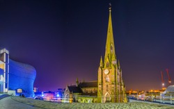 Night view of Saint Martin church surrounded with Bullring shopping mall in Birmingham, England