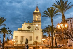 Night view of Saint Peter church and plaza in downtown Huelva, Spain.