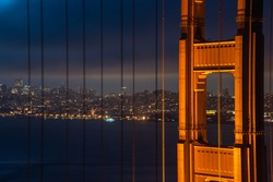 Night view of SanFrancisco and taken through the frame of the Golden Gate Bridge.