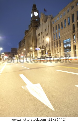 night view of shanghai bund with car lamp track